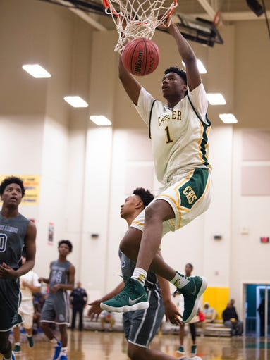 Carver's Jaykwon Walton (1) dunks during the AHSAA