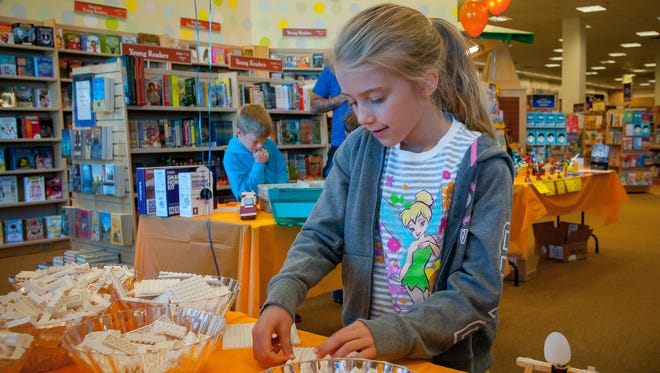 Kathryn Chandler, 8, builds a model park out of Legos during the Mini Maker Faire at the Mesilla Valley Mall Barnes and Noble bookstore.