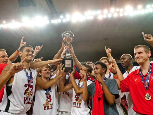 The Ville basketball team celebrates its national title in Freedom Hall. Louisville beat Albany, N.Y. to capture the AAU 11th grade high school basketball championship. 28 July 2014