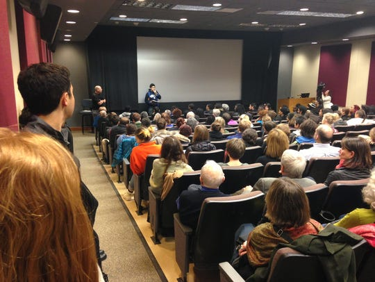 Students and faculty speak Monday night during a forum