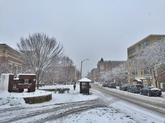 Snow falls along College Street in Burlington late Wednesday afternoon.