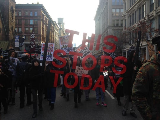 Protesters in New York City carry signs during Saturday's