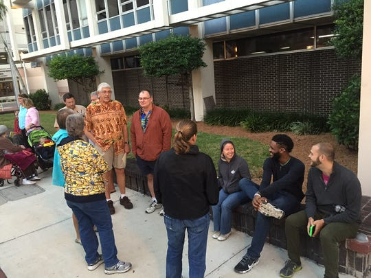 Same-sex couples wait in line at the Lee County Clerk