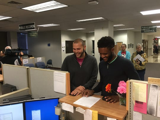 Christian Montgomery and Derek Daniels are the first same-sex couple to get marriage license at the Lee County Clerk of Courts on Jan. 6, 2014