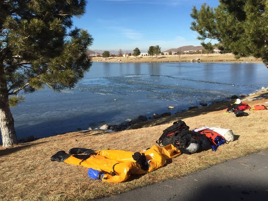 "A first responder's ""duck suit"" dries on the shore after a Rescue effort resulted in a teenage boy being pulled From a frozen pond behind the Vintage apartments In Reno on Jan. 8, 2015."