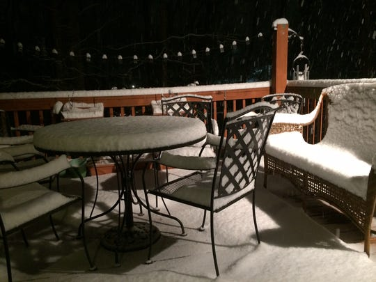 Snow accumulates in East Asheville Wednesday night.