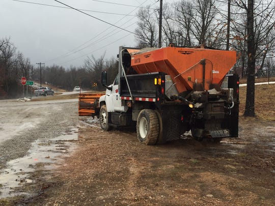 A state snow plow sits stationed at U.S. 62 on the Fulton-Baxter county line awaiting the arrival of Winter Storm Thor at 10:30 a.m. on Wednesday.