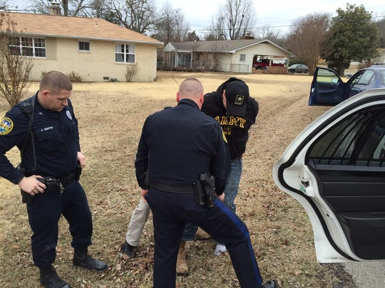 Mountain Home police lead manhunt suspect Danny Bobbitt to a patrol car following his capture at the intersection of Powers Street and Broadmoor Drive at approximately 11:50 a.m. Monday.