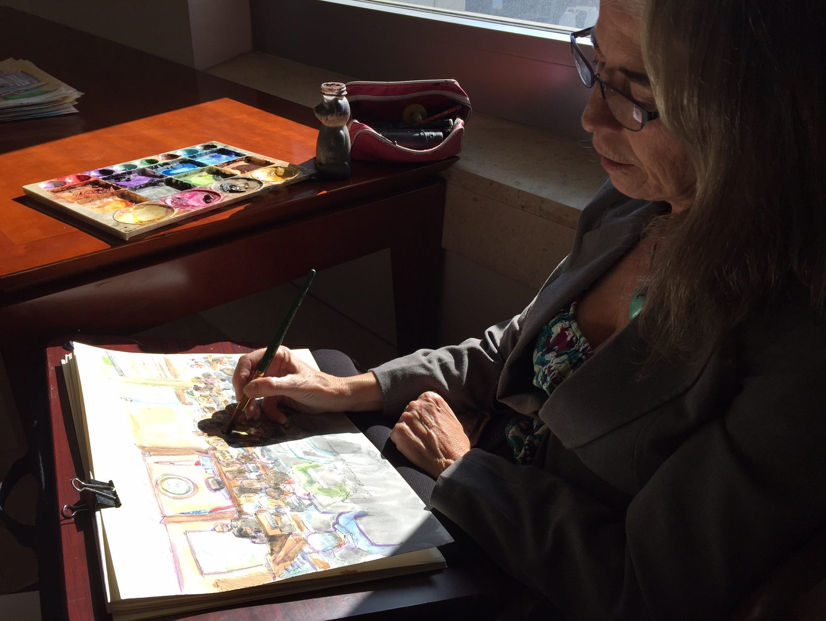 Courtroom artist Vicki Behringer finishes up a sketch at the Ellen Pao trial on March 25, 2015.