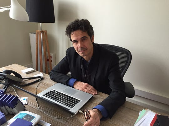 "Paul Moreira in his office in Paris on April 3, 2015. The documentary maker and journalist is the head of a company that shared a building with the satirical newspaper ""Charlie Hebdo."" Moreira's staff were the first to respond to the incident that killed 12 people, including the newspaper's editor."