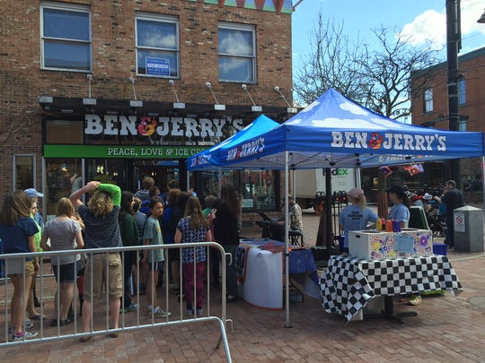 People enter Ben & Jerry's on Church Street Marketplace in Burlington for Free Cone Day Tuesday.