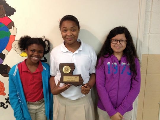 Daija Bickham, Claire Harrington and Perla Juarez received first place in the elementary school geography category at the state social studies fair. The students attend Alice Boucher Elementary.