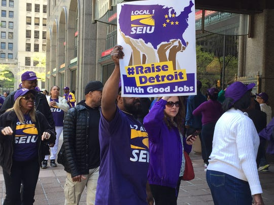 Service Employees International Union workers seeking wage increases demonstrate in New Center on Thursday.