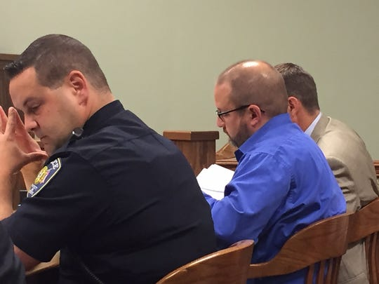 The trial for Clyde-Green Springs Schools Superintendent David Stubblebine, (center), started Thursday. At left is Clyde Police Officer Derrick Shell, who testified for the prosecution.