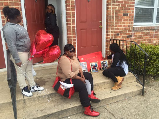 Relatives of fatal shooting victim Arteise Brown set up a memorial of photos near where the shooting took place.