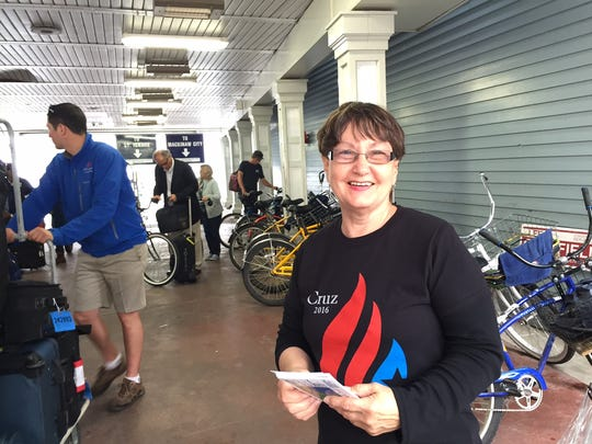 Ted Cruz supporter Barbara Bookout of Grand Rapids was handing out literature at the Shepler's Ferry dock.