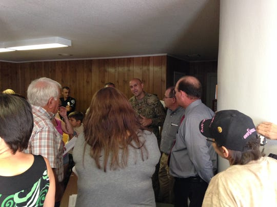 Lt. Col. Brian Sullivan, chief of staff of Fort Polk and the Joint Readiness Training Center, speaks to people at a public meeting concerning the horses that roam Fort Polk.