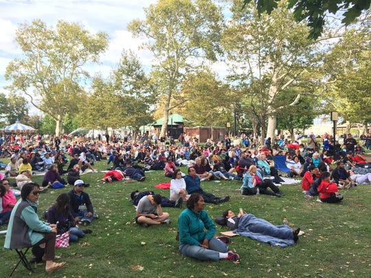 The crowd at the Jumbotron in Franklin Square Park in Philadelphia has grown significantly to about 200 people.