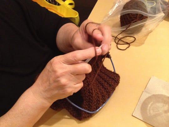 Knitting and crocheting bring threads and lives together for this knitting group.