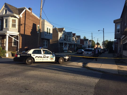 Wilmington police block off a street while investigating a shooting at West 27th and Enterprise streets late Thursday afternoon.