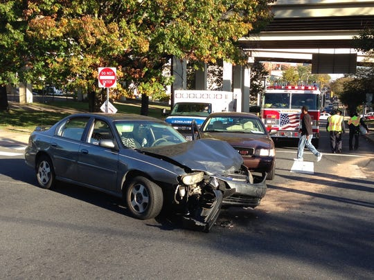 One car had heavy front-end damage after crashing into an SUV and another vehicle, believed to be that of a plainclothes police officer, Wednesday afternoon in Wilmington.