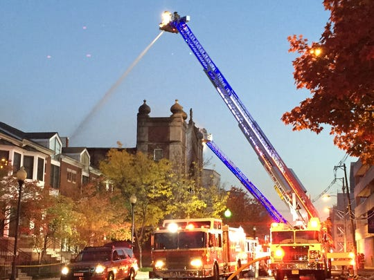 Firefighters working to extinguish a blaze that destroyed Congregation Poile Zedek in 2015.