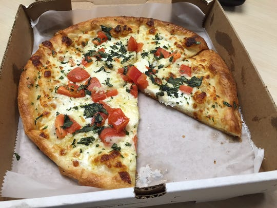 A Margherita pizza from Paisano's Pizzeria