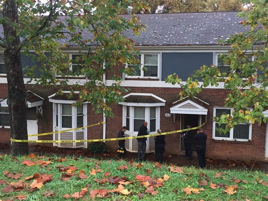 Police officers investigate the fatal shooting at Pisgah