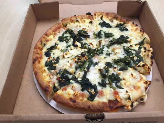 Pizza with spinach and feta cheese from Founaris Bros.