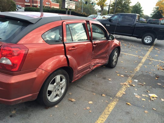 A car belonging to a shopper at Walgreens suffered severe damage after a man hit it, police said, while trying to evade them.