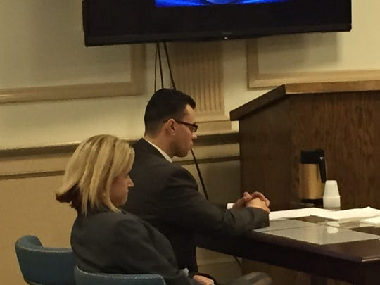 Andrew Pena listens as a Morris County jury on Nov. 10, 2015 finds him guilty of aggravated sexual assault. Beside him is standby legal counsel Elizabeth Martin.