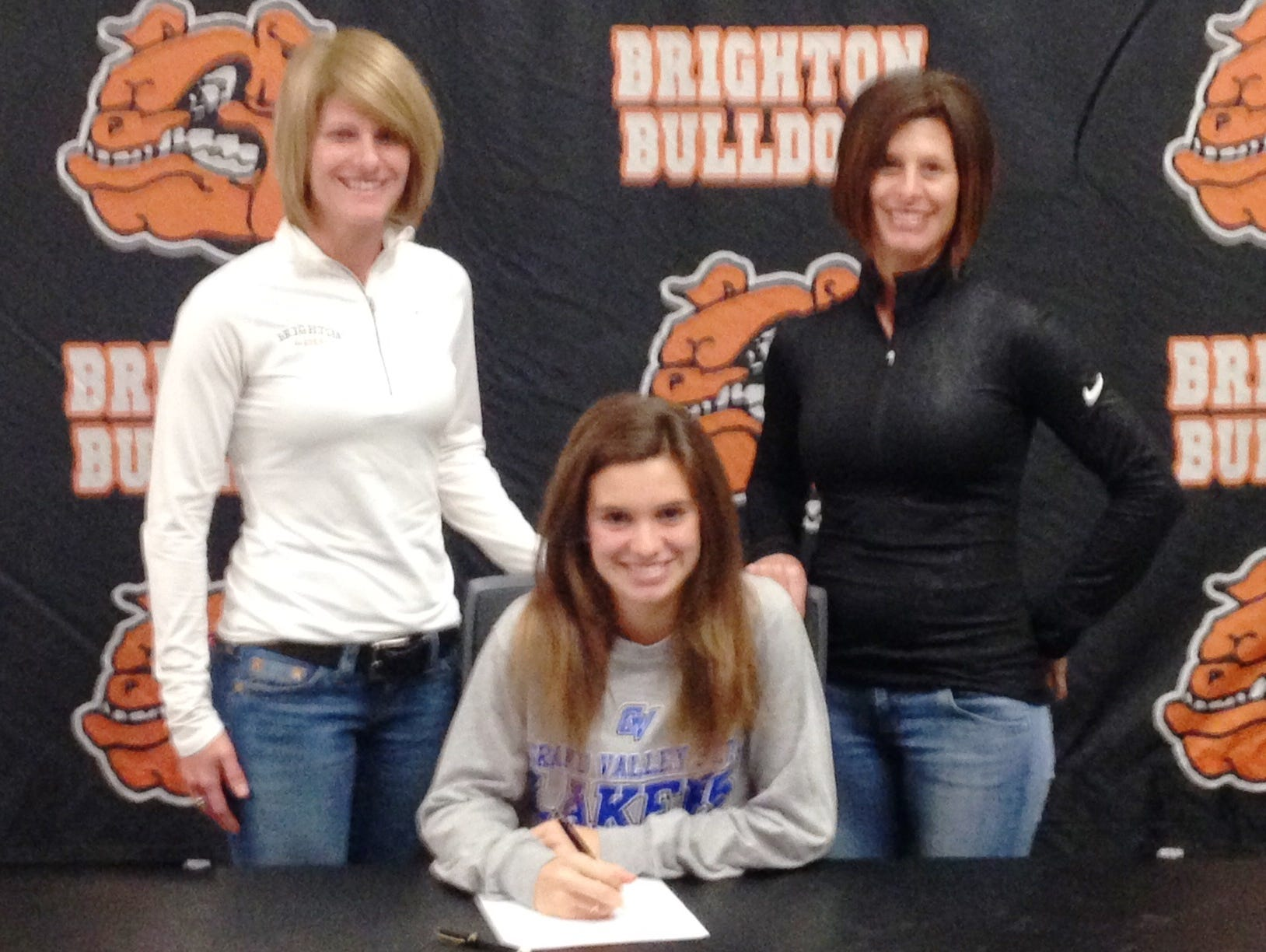 Brighton's Jenna Sica signed with Grand Valley State University on Wednesday alongside her cross country coach Kristi Matuszewski, left, and her mom Shelly, right.