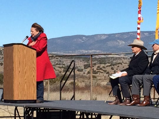 Gov. Susana Martinez dedicates the Fort Stanton State Veterans Cemetery as NM Department of Veterans Services Secretary Jack R. Fox and U.S. Sen. Tom Udall look on.