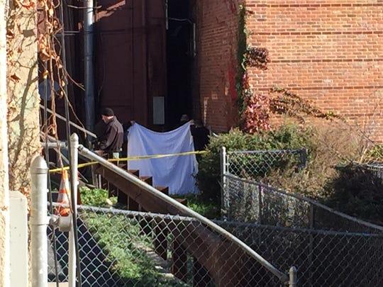 investigators shield the scene of the discovery of