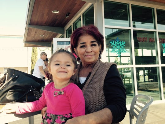 Birtha Gomez spends time with her family and granddaughter, 3-year-old Maya Franco, on Tuesday at the Fountains at Farah. Gomez and her family are ready for Black Friday shopping to commence.