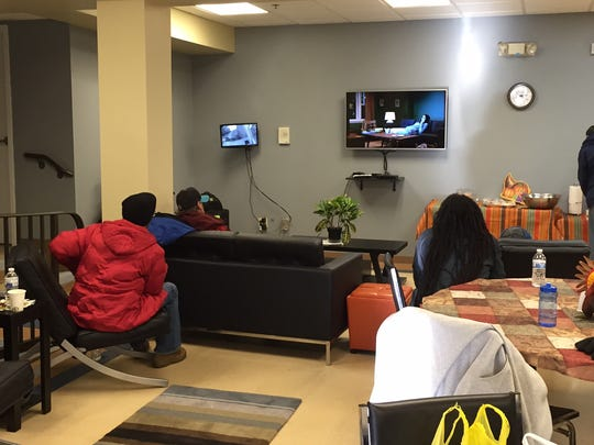 Guests watch television at Our Promise, a drop-in center for the homeless in the basement of the First Baptist Church in Morristown.