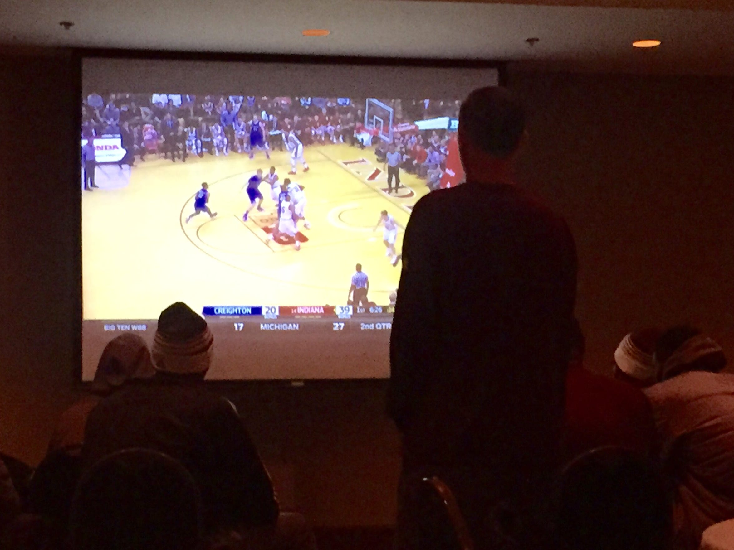 ASU coach Bobby Hurley watches film at the team hotel