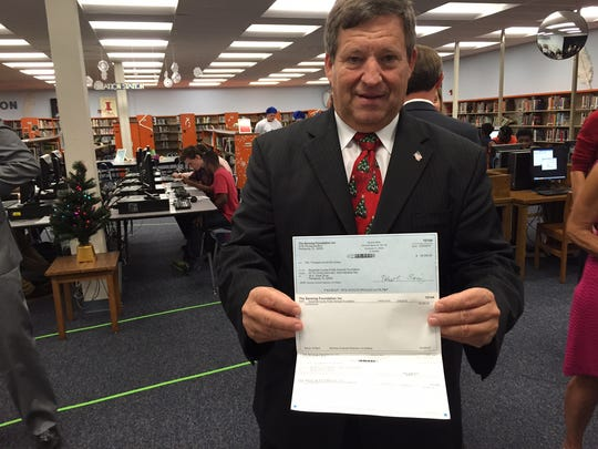 Escambia Superintendent Malcolm Thomas poses with the