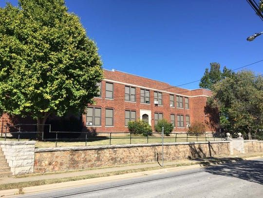 The former Bailey school at 501 E. Central St. is up