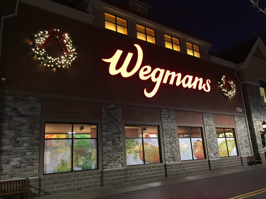 Santa Claus bought groceries for people in need at the East Avenue Wegmans on Tuesday, Dec. 22, 2015.