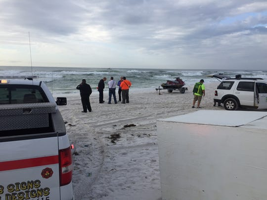 Officials are searching for a missing swimmer on Navarre