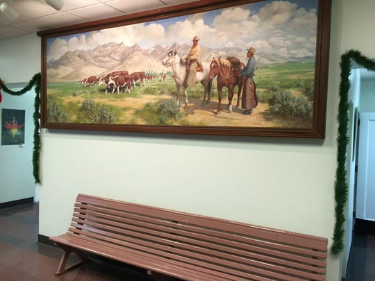A Western cattle scene dominates the foyer of the Harney County Courthouse in Burns, Ore., in mid-December 2015. Ranching remains a key to the area's economy as timber harvests have declined. Ranchers rely on a mix of private and public land to feed cattle. (Les ZaitzThe Oregonian via AP)