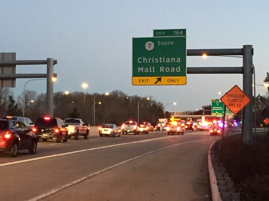 Traffic crawls to a stop on Rt. 1 northbound near the Christiana Mall where a pedestrian was struck and killed Tuesday morning on the northbound flyover ramp to I-95.