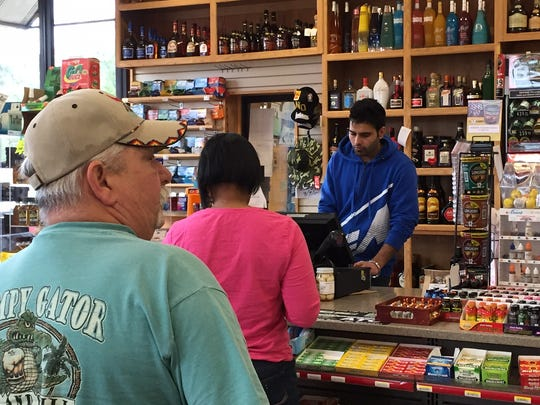 Customers line up for a Powerball ticket.  As of Friday morning, the jackpot was estimated at $800 million