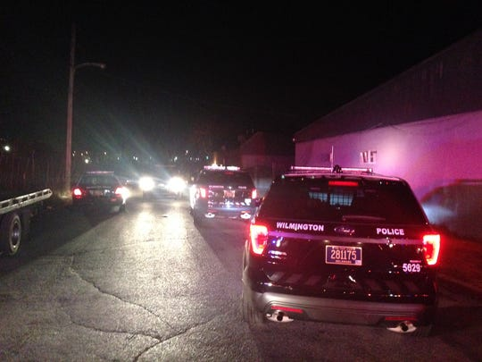 Police investigate a shooting on Locust Street in Wilmington on Wednesday night.