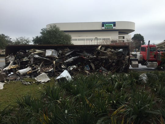 The trailer of a semi truck overturned on N. Alcaniz across from the Bay Center. No injuries, not blocking traffic.