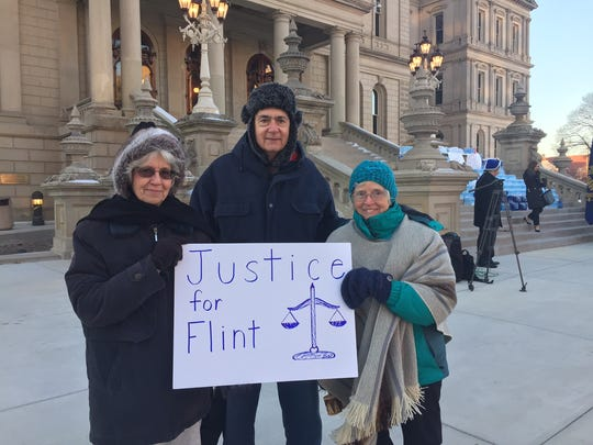 Al and Bonnie DiGennaro of Battle Creek traveled to Lansing with a protest sign and their neighbor, Veroneze Strader (right).