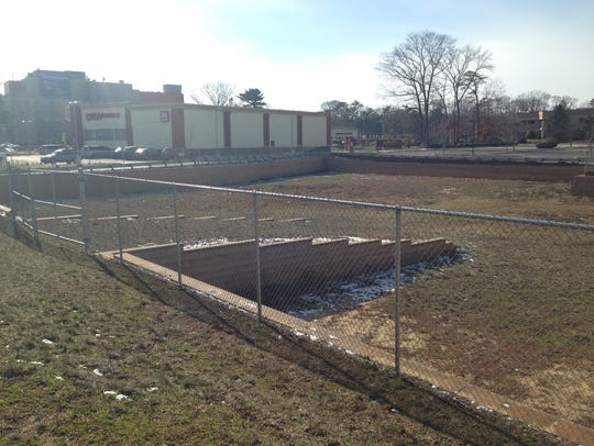 The site of a proposed Wawa convenience store and gas