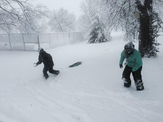 Eli Stein, 12, prepares to lob a snowball at his sister, Anke, 10, at Elmington Park on Friday.