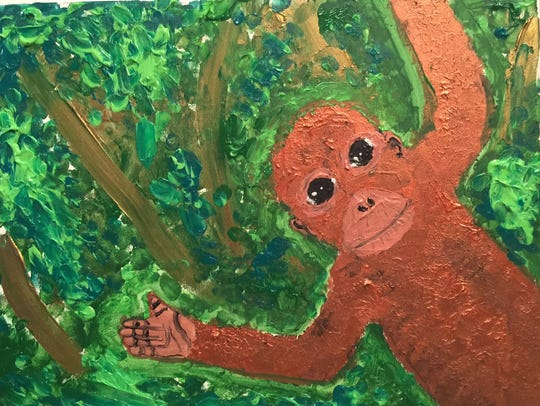 """Artist Bria Neff, 9, painted this work, """"Save the Trees,"""